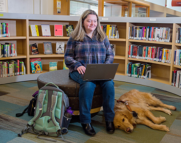Student studying with assistive technology in the Library.