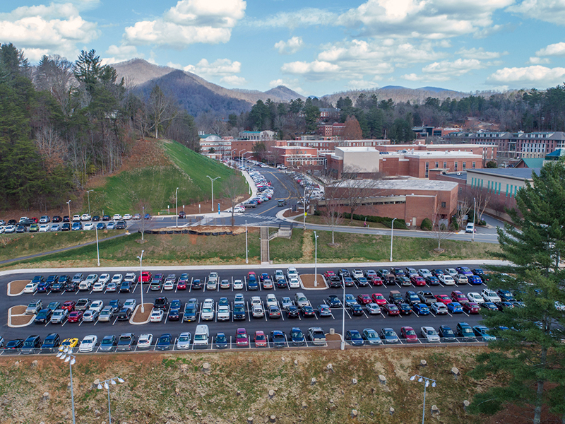 An aerial shot of the band practice field parking lot.