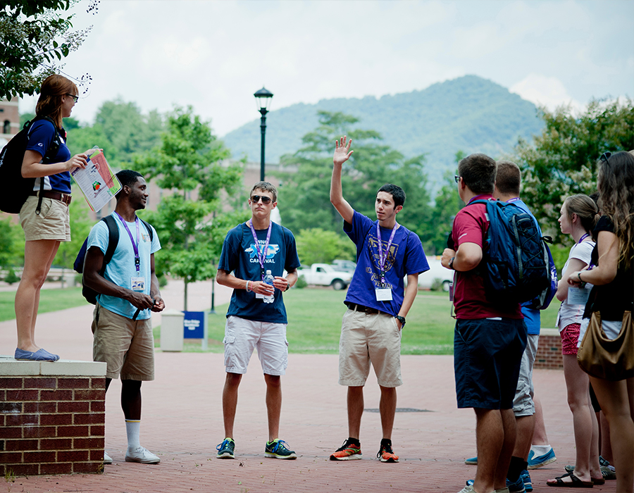 Students at an Open House event, taking a tour of WCU's Campus