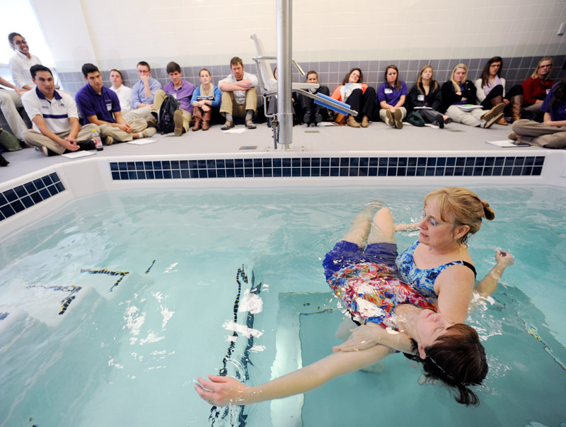 Recreational therapy students learning about Aquatic Therapy at a pool